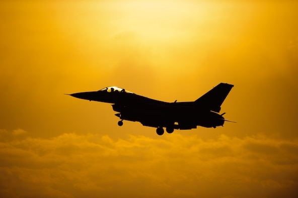 An 80th Fighter Squadron pilot comes in for a sunset landing after completing a sortie at Kunsan Air Base, Republic of Korea, May 7, 2014. Beverly Bulldog 14-2 tested Kunsan's ability to tackle obstacles on the ground and air to ensure continued operations. (U.S. Air Force photo by Senior Airman Armando A. Schwier-Morales/Released)