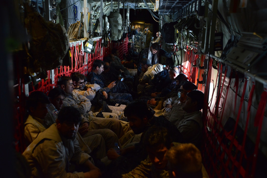 KABUL INTERNATIONAL AIRPORT, Afghanistan – Afghan National Army soldiers and advisors relax as they fly aboard a C-130 J-30 assigned to the 774th Expeditionary Airlift Squadron, 455th Air Expeditionary Wing May 5, 2014. The team was flown to Fayzabad Airport by Coalition Forces so they could make their way to the Badakhshan province, which experienced a mudslide May 2 that is responsible for the loss of lives and damages of a village. (U.S. Air Force photo by Master Sgt. Cohen A. Young)