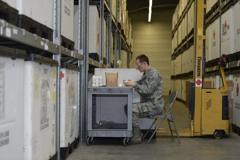 U.S. Air Force Staff Sgt. James Bishop, 52nd Medical Support Squadron medical logistics technician from Fort Worth, Texas, applies updated medication labels at the 52nd MDSS warehouse in Zemmer, Germany, May 5, 2014. The U.S. Food and Drug Administration's Shelf Life Extension Program tests to ensure the effectiveness of medication approaching expiration and extends the shelf life if it meets FDA standards of extension. (U.S. Air Force photo by Staff Sgt. Christopher Ruano/Released)