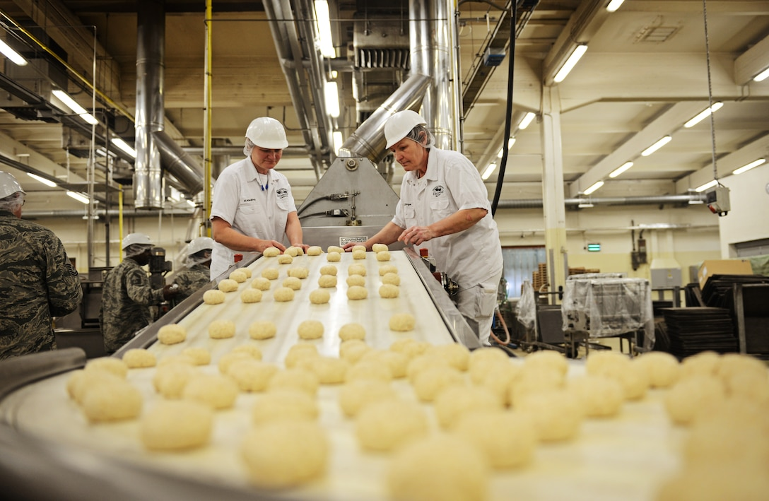 Tortilla dough rolls down the production line at the Army and Air Forces Exchange Service bakery plant in Gruenstadt, Germany April 30, 2014. The Gruenstadt facility is the central production location for more than 250 line items, as well as cold storage for 200 line items and even produces five million gallons of Culligan bottled water each year. The plant distributes to more than 100 locations in 25 countries and has been in business since 1953. (U.S. Air Force photo/ Staff Sgt. Ryan Crane)