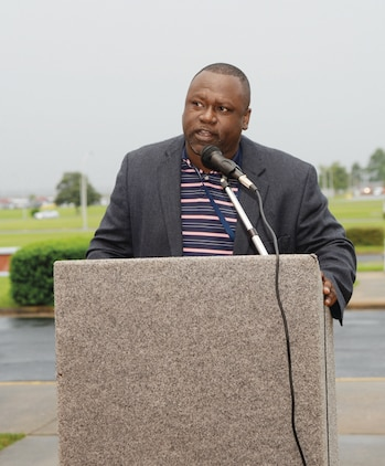 Lawrence Floyd, command security manager, Marine Corps Logistics Command, provides insight on the importance of prayer while speaking to Marines and civilian-Marines  during the National Day of Prayer, May 1, 2014, in front of Coffman Hall.