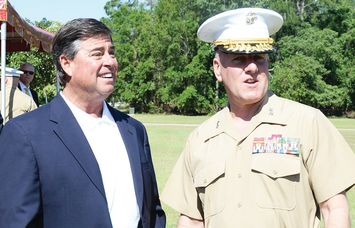 Maj. Gen. John J. Broadmeadow, commanding general, Marine Corps Logistics Command, and Jeff Sinyard, commission chairman, Dougherty County, engage in discussion after a ceremony aboard Marine Corps Logistics Base Albany, May 6, 2014. LOGCOM was the recipient of the Meritorious Unit Commendation.