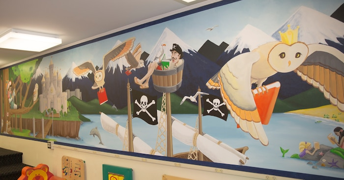 Gwyn Korpi, a military spouse and graphic designer, painted a mural at the at the children's area of the Harriotte B. Smith Library aboard Marine Corps Base Camp Lejeune. The mural is designed to pique children's interests with a fairy tale world that could be the setting of many works of children's fiction.