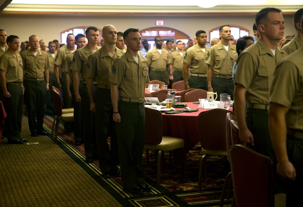 Marines filled the banquet room at the Sonoran Pueblo aboard Marine Corps Air Station Yuma, Ariz., April 27, for the Weapons and Tactics Instructor Course 2-14 graduation ceremony. Following the invocation read by Navy Lt. Keith Lightner, the chaplain for Marine Aircraft Group 13, the Marines came to attention as the National Anthem played during the Weapons and Tactics Instructor Course 2-14 graduation ceremony at the Sonoran Pueblo aboard Marine Corps Air Station Yuma, Ariz., April 27.