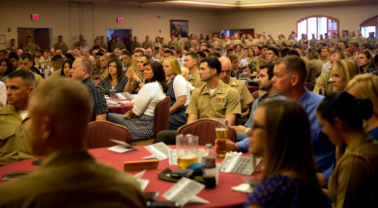 Hundreds of Marines, sailors, airmen and civilians listen attentively as the guest speaker, Lt. Gen. Jon M. Davis, Deputy Commander of United States Cyber Command, addresses the crowd during the Weapons and Tactics Instructor Course 2-14 graduation ceremony at the Sonoran Pueblo aboard Marine Corps Air Station Yuma, Ariz., April 27.