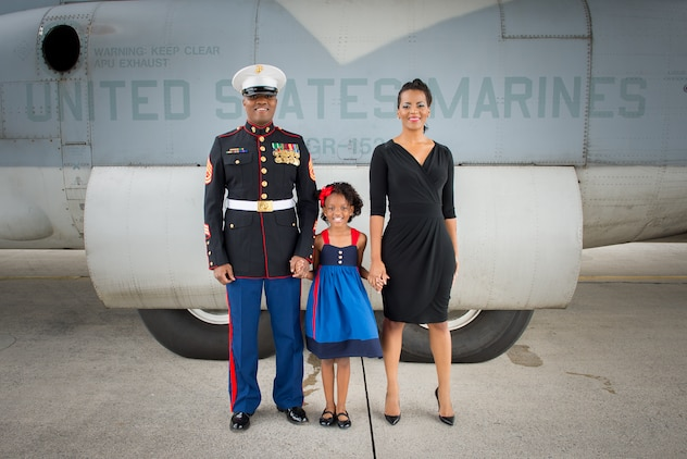 2014 Marine Spouse of the Year Lakesha Cole poses with her daughter, Kailey, 8, and her husband, Gunnery Sgt. Deonte Cole.The award recognizes military spouses' important contributions and commitment to their spouse and the military community.