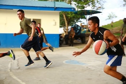 Members of the Philippine Air Force and U.S. Marine Corps compete in a friendly basketball match at Crow Valley, Philippines, May 5, 2014, to mark the end of the opening day of Balikatan 2014. Balikatan is an annual training exercise that strengthens the interoperability between the Armed Forces of the Philippines and U.S. military in their commitment to regional security and stability, humanitarian assistance and disaster relief.