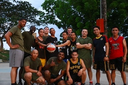 Members of the Philippine Air Force and U.S. Marine Corps pose for a group photo following a friendly basketball match at Crow Valley, Philippines, May 5, 2014, to mark the end of the opening day of Balikatan 2014. Balikatan is an annual training exercise that strengthens the interoperability between the Armed Forces of the Philippines and U.S. military in their commitment to regional security and stability, humanitarian assistance and disaster relief.