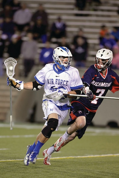 Air Force junior Nate Hruby looks to make a pass against Richmond at Falcon Field Wednesday. Air Force lacrosse beat Richmond 13 - 5, picking up their first-ever NCAA Tournament win. (U.S. Air Force Photo/Sarah Chambers)
