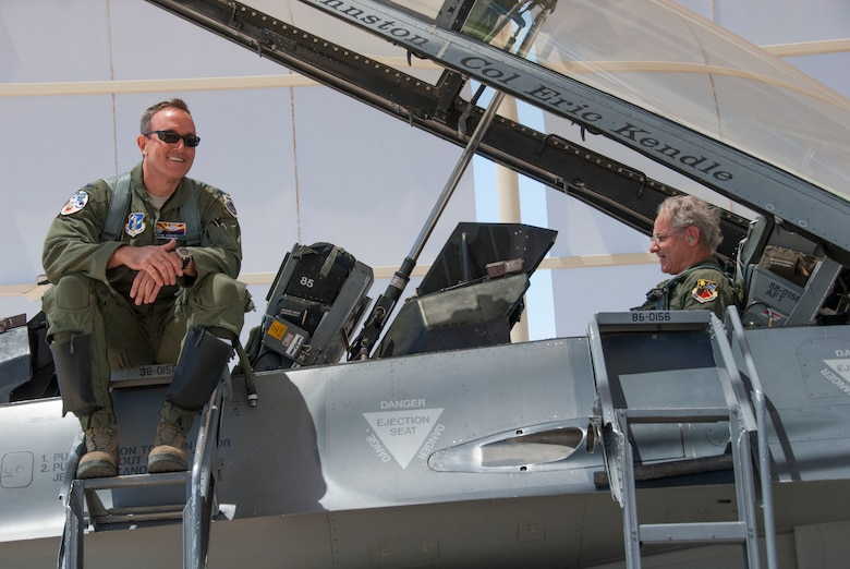 Jonathan Rothschild, Mayor of Tucson, gets settled into the F-16 Fighting Falcon while Col. Phil Purcell, Commander of the 162nd Wing, waits for the crew chiefs to complete the remainder of aircraft checks, May 3.  Rothschild was provided with all the essential training he needed before he was taken up on his orientation flight. (U.S. Air National Guard photo by Staff Sgt. Dina Farmer/Released)