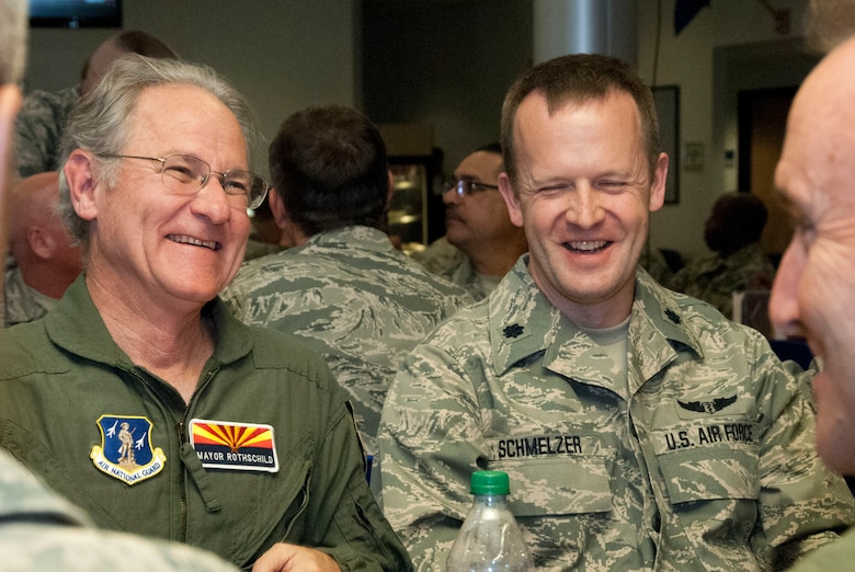 "Jonathan Rothschild, Mayor of Tucson, shares a laugh with Lt Col Christopher Schmelzer and Col. Howard ""Phil"" Purcell, commander of the 162nd Wing , while having lunch at the dining facility at the 162nd Wing May 3.  Rothschild was invited to the 162nd Wing to participate in an orientation flight, which raises awareness and understanding about the wing's mission.  (U.S. Air National Guard photo by Tech. Sgt. Hollie Hansen/Released)"