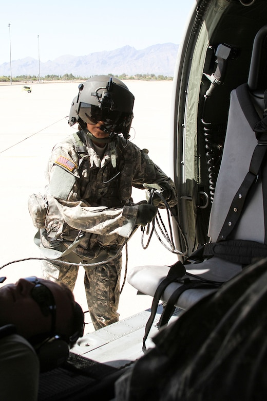Spc. Nancy Gonzalez, a loadmaster assigned to the 7th Battalion, 158th Aviation Regiment of the Army National Guard, prepares the Blackhawk HH-60M Medevac helicopter for takeoff during a simulated casualty evacuation scenario as part of Exercise ANGEL THUNDER at Davis-Monthan AFB, Ariz., May 7, 2014.  ANGEL THUNDER is a multilateral annual exercise that to supports DoD's training requirements for Personnel Recovery responsibilities through high–fidelity exercises.  Exercise ANGEL THUNDER focuses on scenarios that rescue forces are likely to face in current and future contingencies—increasing their combat readiness across a range of military options. (U.S. Air Force photo by Tech. Sgt. Heather R. Redman/Released)