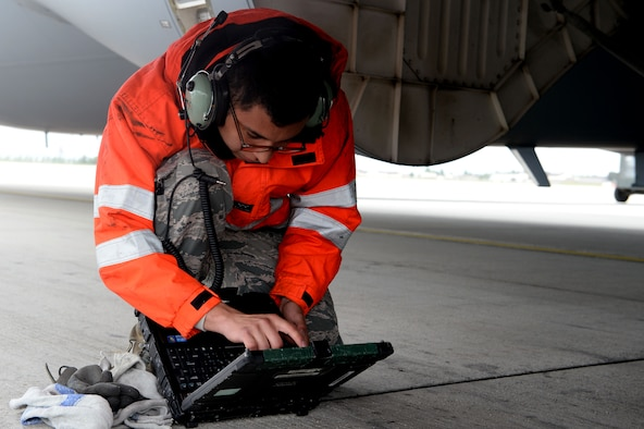 U.S. Air Force Senior Airman Nestor Fraga, 726th Air Mobility Squadron crew chief from Crossville, Tenn., references his Digital Technical Order System during a post-flight inspection of a U.S. Air Force C-17 Globemaster III Cargo Aircraft at Spangdahlem Air Base, Germany, May 7, 2014. Crew chiefs use their DTOS for reference to all maintenance practices. (U.S. Air Force photo by Senior Airman Alexis Siekert/Released)