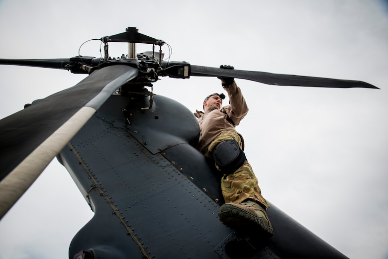 Tech. Sgt. Mathias Hauser, inspects the rotor blades of an HH-60G Pave Hawk May 6, 2014, at Flagstaff Pulliam Airport, Ariz. One of Hauser's responsibilities is to conduct preflight inspections to ensure the aircraft is mission ready. Hauser is a 41st Rescue Squadron special mission's aviator out of Moody Air Force Base, Ga. (U.S. Air Force photo/Staff Sgt. Jamal D. Sutter)
