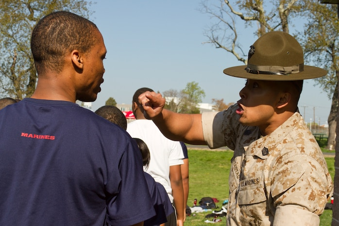 U.S. Marine Corps Gunnery Sgt. Pierre Tedtaotao, a drill instructor with the United States Naval Academy, motivates a member of Marine Corps Recruiting Station Baltimore's delayed entry program during RS Baltimore's annual statewide pool function at Aberdeen Proving Grounds, Md., April 26, 2014. The purpose of the statewide pool function is to build camaraderie among the members of the delayed entry program while physically and mentally preparing them for recruit training. (U.S. Marine Corps photo by Sgt. Bryan Nygaard/Released)