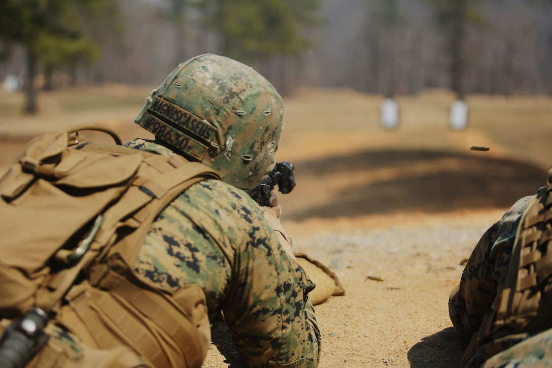 """Corporal Ian Phillips, a squad automatic weapon gunner with Scout Platoon, 2nd Tank Battalion, 2nd Marine Division, and native of Savannah, Ga., fires his M4 Carbine at targets during unknown distance training as part of the Combat Marksmanship Training at Ft. Pickett, Va., April 2, 2014. """"It is good to know you hit the target and if it were an enemy trying to kill you or your brothers that you can take him out first,"""" said Cpl. Patrick W. Westcott, a Tiverton, R.I. native and team leader with Scout Platoon."""