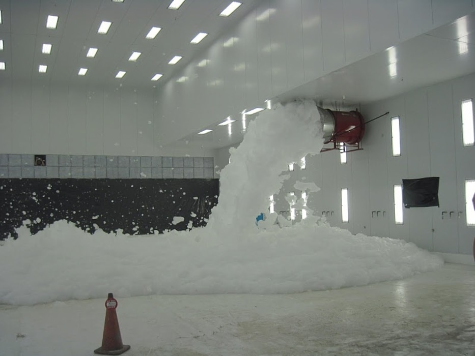 HOLLOMAN AIR FORCE BASE, N.M., -- As part of commissioning, the Hi-Ex foam fire suppression system at Alter Hangar 898 was tested.  Up to a meter of foam covered the floor in approximately one minute. Photo by Daniel Garcia, Aug. 24, 2011.
