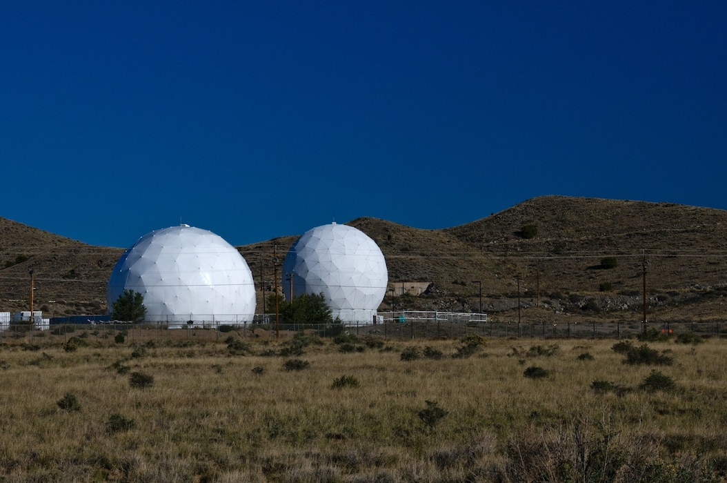 "KIRTLAND AIR FORCE BASE, N.M. – Two RADOMEs are seen in this 2011 District photo drive submission.  The word ""RADOME"" originated during the 1940s and comes from blending the words ""radar"" and ""dome.""  Photo by Richard Banker, Oct. 24, 2011."