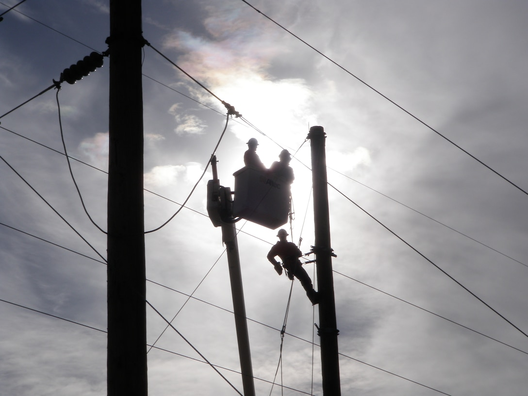 ALBUQUERQUE, N.M., -- Electrical subcontractors work on a power pole relocation as part of the District's Southwest Valley Flood Damage Reduction Project. Photo by Jacob Chavez, Jan. 25, 2011.