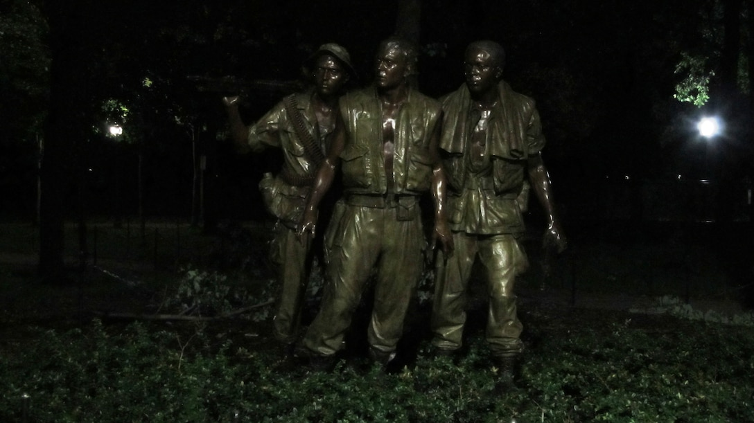 WASHINGTON, D.C., -- This photo of a statue of Vietnam Veterans was taken around midnight after Hurricane Irene had blown through the nation's capital, Aug. 28, 2011. Maj. Phil Bundy was in Washington, D.C. supporting the Corps' disaster relief efforts.