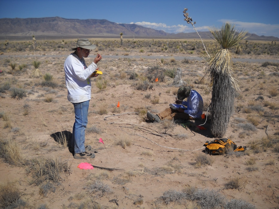 WHITE SANDS MISSILE RANGE, N.M. – District archaeologists document artifact and archaeological site data, June 22, 2011. Photo by Gregory Everhart.