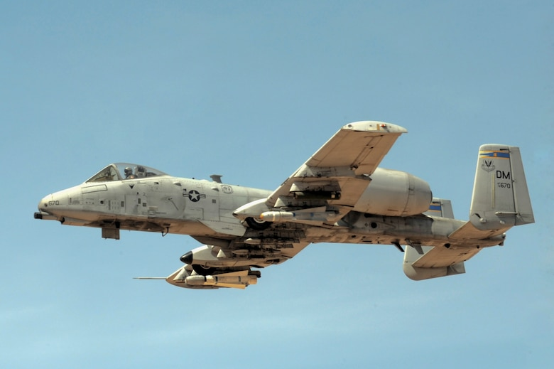 An A-10 Thunderbolt from the 354th Fighter Squadron flies through the air during a strafing run at Barry M. Goldwater Air Force Range in Wellton, Ariz., May 5, 2014. The 354th FS is sending approximately 130 individuals, from maintainers to pilots, as well as eight A-10 aircraft to Eielson Air Force Base, Alaska, to participate in a Red Flag exercise until May 23. (U.S. Air Force photo by Airman 1st Class Chris Drzazgowski/Released)