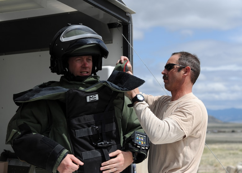 Tech. Sgt. Scott Lawson, 120th Airlift Wing Explosive Ordnance Disposal technician, gets dressed in the Explosive Ordinance Disposal-9 bomb suit. The EOD teams perform their training at Ft. Harrison in Helena, Mont., because it opens up more options for them to practice and utilize their supplies. (U.S. Air Force photo/ Airman 1st Class Joshua Smoot)