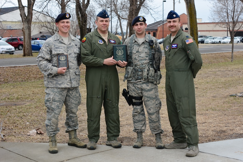 (From left) Master Sgt. Ben Israel, 139th Security Forces Squadron, Lt. Col. Ron Douglas, 180th Airlift Squadron, Airman 1st Class Williams, 139th Security Forces Squadron, and Capt. Mark Hanna, 180th Airlift Squadron pose for a photo at Rosecrans Air National Guard Base, Mo., March 27, 2014. This was one of three teams from the 139th Airlift Wing that competed in the Missouri National Guard Adjutant General's Combat Tournament. (U.S. Air National Guard photo by Tech. Sgt. Michael Crane/Released)