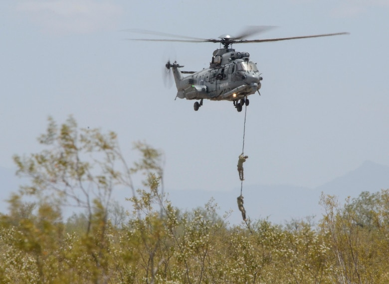 A French Eurocopter EC-735 Caracal hovers while personnel aboard fastrope down during Alternate Insertion Extraction  training during Exercise ANGEL THUNDER May 07, 2014 at Davis-Monthan Air Force Base, Ariz. ANGEL THUNDER 2014 is the largest and most realistic joint service, multinational, interagency combat search and rescue exercise designed to provide training for personnel recovery assets using a variety of scenarios to simulate deployment conditions and contingencies. Personnel recovery forces will train through the full spectrum of personnel recovery capabilities with ground recovery personnel, air assets, Special Forces teams and federal agents. (U.S. Air Force photo by Staff Sgt. Adam Grant/Released)