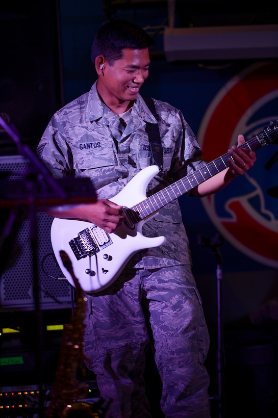 U.S. Air Force Central Command's band, Hypersonic, performs for members of the 386th Air Expeditionary Wing on May 3, 2014 at an undisclosed location in Southwest Asia. The band spent four days touring the region, performing for deployed troops to boost morale and reaching out to host nation communities. Hypersonic is deployed from Yokota Air Base, Japan. (U.S. Air Force photo by Staff Sgt. Jeremy Bowcock)