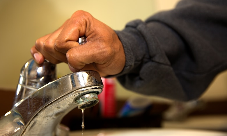 A Marine turns off the faucet while preparing for work aboard Marine Corps Air Station Miramar, Calif., May 9. Marines, Sailors, families and civilians working and living aboard the air station take part in fighting the drought in California by cutting their water usage wherever they can.