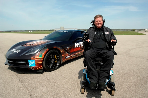 Sam Schmidt, former Indy Racing League driver, is stationed in front of a Semi-Autonomous Motorcar know as SAM which he drove 84 mpr on the runway next to the National Museum of the United States Air Force during a demonstration to showcase new human performance technologies on May 6. (USAF photo by Al Bright)