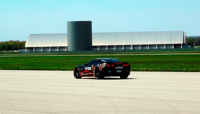 Sam Schmidt drives a 2014 Corvette C7 Stingray car down the runway next to the National Museum of the United States Air Force. Schmidt, a quadriplegic, demonstrated his ability to control the car. (USAF photo by Al Bright)