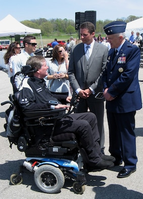 Maj. Gen. Thomas Masiello, commander of Air Force Research Laboratory and James Christensen, research psychologist with 711 Human Performance Wing talk to Sam Schmidt, a quadriplegic and former Indy Racing League driver, about driving again. (USAF photo by Ted Theopolos)