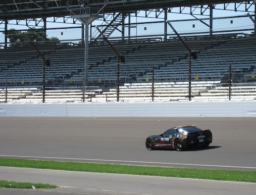 Sam Schmidt, former Indy Racing League driver, drives the Semi-Autonomous Motorcar known as SAM at Indianapolis Motor Speedway (IMS) on April 23. Schmidt, a quadriplegic, plans to return to IMS on May 18 and break the 84 mph speed time he set on May 6 at Wright-Patterson AFB. (USAF photo by Ted Theopolos)