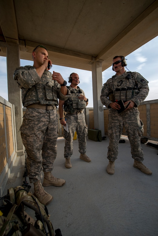 U.S. Air Force Staff Sgt. Jacob Noojin (left) and Senior Airmen Daniel Wolcott (center) and Michael Bradley (right) coordinate air support during a Joint Operations live fire exercise on May 7, 2014 at an undisclosed location in Southwest Asia. TACPs are composed of Joint Terminal Attack Controllers who provide terminal attack control and fire support expertise for all U. S. Army and U.S. Navy Special Forces and special missions units. (U.S. Air Force photo by Staff Sgt. Jeremy Bowcock))