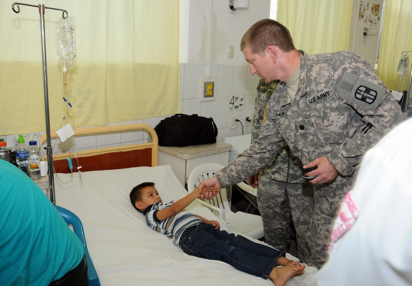 U. S. Army Lt. Col. Mark Talbert greets a five-year-old Honduran boy during a pre-operative visit May 6.  His case is one of eight surgeries performed by the Joint Task Force-Bravo's Mobile Surgical Team and the surgical staff of the Santa Rosa hospital in the city of Santa Rosa de Copan, Department of Copan, Honduras during a Medical Readiness Training Exercise May 5-9.  These surgeries, which are often very expensive for Honduran nationals, were provided free of charge.  The work of the MST helped support Honduran medical capabilities while continuing to strengthen the relationship between JTF-Bravo and its partner nation.  (Photo by U. S Air National Guard Capt. Steven Stubbs)