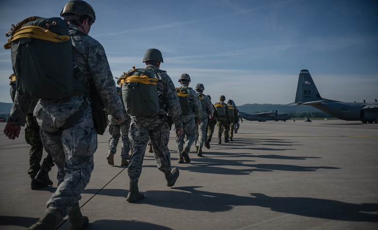 American service member parachutists, along with parachutists from eight visiting countries, prepare to board a C-130J Super Hercules as part of International Jump Week on Ramstein Air Base, Germany, May 5, 2014. A total of 97 foreign and allied partners tested, built and strengthened partnerships during jump week alongside American Airmen and Soldiers. (U.S. Air Force photo/Airman 1st Class Jordan Castelan)