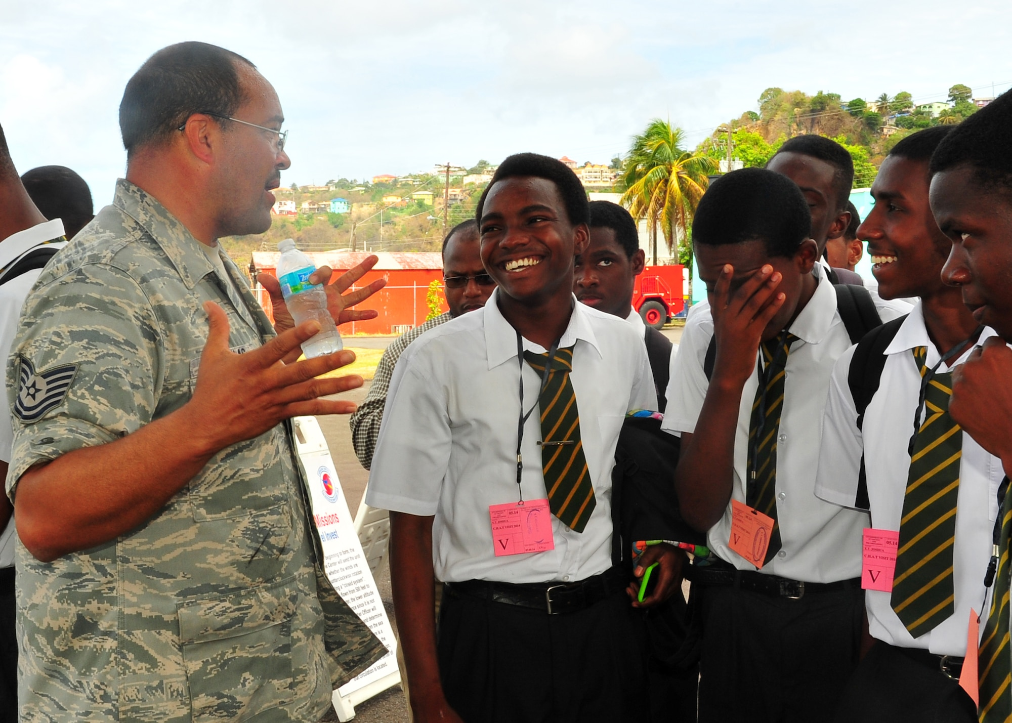 Tech. Sgt. Clinton Nicholas answers student's questions during a tour of the WC-130J Hercules May 9, 2014, at the E.T. Joshua Airport, St. Vincent. Nicholas was part of the Caribbean hurricane awareness tour, or CHAT, May 4-11. CHAT is a joint effort between the National Oceanic and Atmospheric Administration's national hurricane center and the 403rd Wing's 53rd Weather Reconnaissance Squadron. The tour promotes hurricane awareness and preparedness throughout the Caribbean region. Nicholas is a 403rd Aircraft Maintenance Squadron dedicated crew chief. (U.S. Air Force photo/Maj. Marnee A.C.Losurdo)