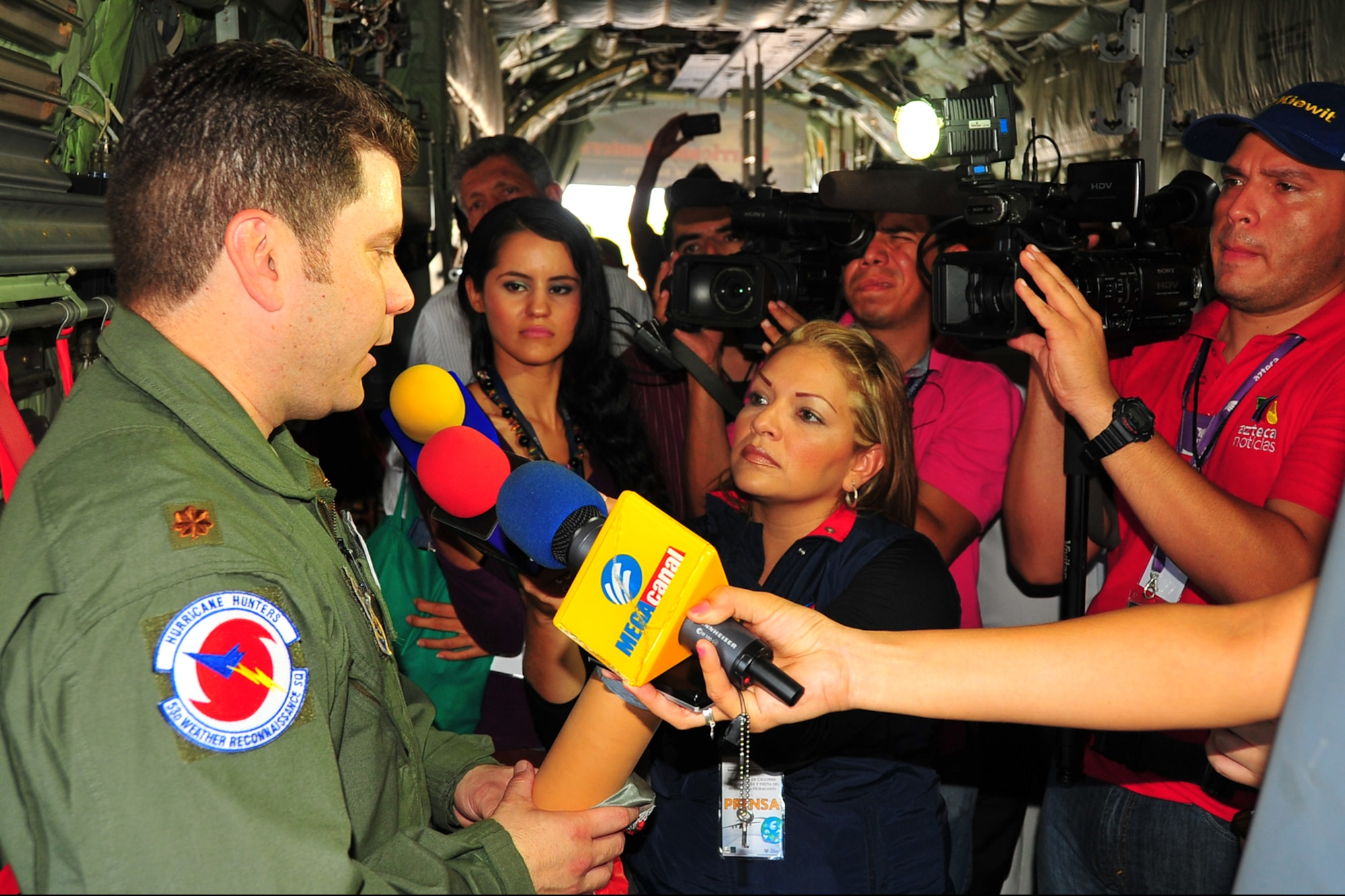 Maj. Rafael Salort participates in a Mexican media interview during the Caribbean hurricane awareness tour, or CHAT, May 5, 2014 at Manzanillo International Airport, Mexico. CHAT is a joint effort between National Oceanic and Atmospheric Administration's national hurricane center and the 403rd Wing's 53rd Weather Reconnaissance Squadron. The tour promotes hurricane awareness and preparedness throughout the Caribbean region. Salort is a 53rd Weather Reconnaissance Squadron navigator. (U.S. Air Force photo/Maj. Marnee A.C. Losurdo)