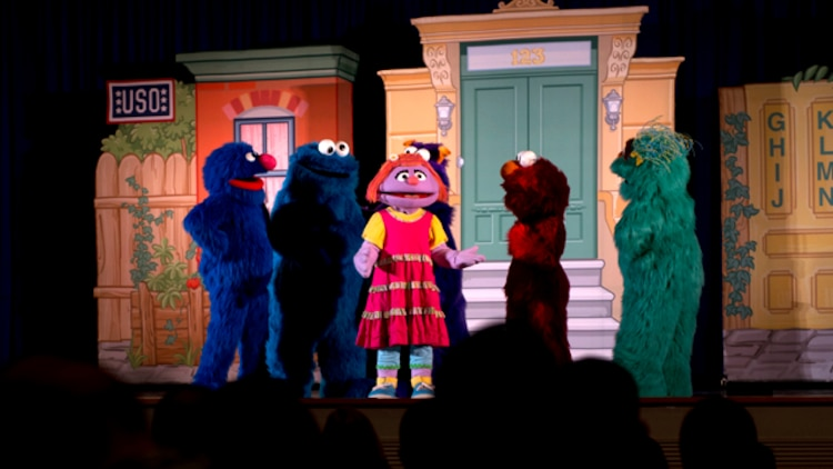 Characters from the Sesame Street/USO Experience for Military Families traveling tour perform at Little Hall aboard Marine Corps Base Quantico May 8. The tour is scheduled to perform 200 shows at 69 military bases in 32 states.