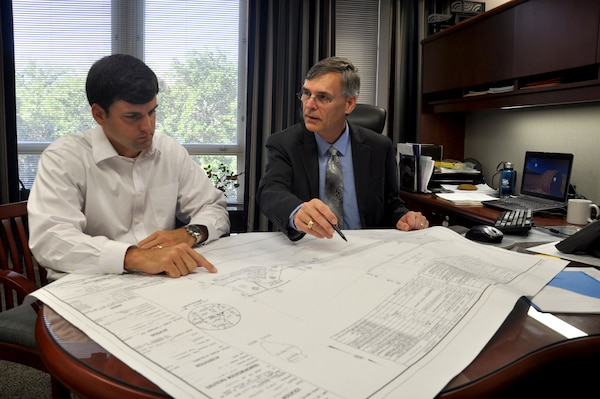 Real Property Exchange manager Stephen Bruce (left) and Real Estate Division Chief Ralph Werthmann review project drawings for Army Reserve property in Orland Park, Illinois.