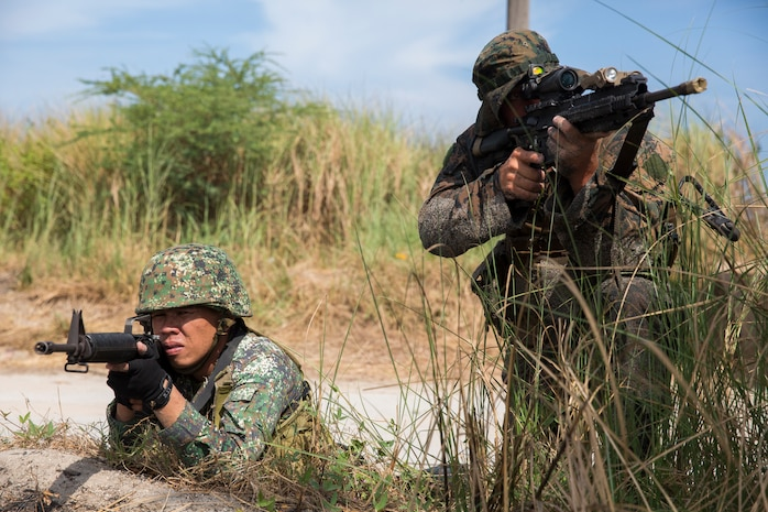 A Philippine and U.S. Marine train their rifles at potential targets following a beach assault during a bilateral exercise near Zambales, Philippines, May 9, 2014 as part of Balikatan 2014. The assault enhanced Marine landing maneuvers and expeditionary capabilities, optimizing combined operations for the future. Balikatan is an annual training exercise that strengthens the interoperability between Armed Forces of the Philippines and U.S. military in their commitment to regional securing and stability, humanitarian assistance and disaster relief.