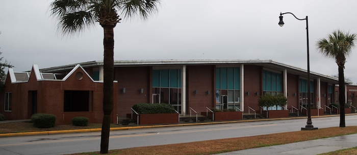 The old Marine exchange building is scheduled for demolition in May 2014, on Parris Island, S.C. The building was built in 1969 and was shut down after the completion of the current Marine Corps Exchange in 2008. In recent years, the building was used as temporary office space. Parris Island's intent is to eventually transform the site, through a separately funded project, into a park that can be used by visitors and families who travel to here for graduations. (Photo by Cpl. David Bessey)
