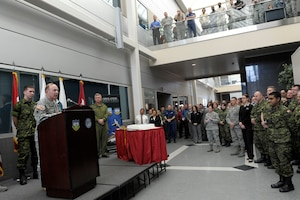 Army Gen. Charles 'Chuck' Jacoby, North American Aerospace Defense Command and U.S. Northern Command commander, speaks to a crowd of command members in the atrium of the headquarters building on Peterson Air Force Base, Colo. The crowd gathered to celebrate NORAD's 56 birthday.  Photo by Air Force Master Sgt. Andy Bellamy/Released.