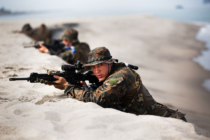 """U.S. Marines with 3rd Reconnaissance Battalion conduct a """"hasty beach report"""" during an amphibious landing exercise between the Philippine and the U.S. Marine Corps at the Naval Education Training Center here May 9. The training evolution, as part of Balikatan 2014, aimed at enhancing interoperability and strengthening the Philippine-U.S. relationship."""