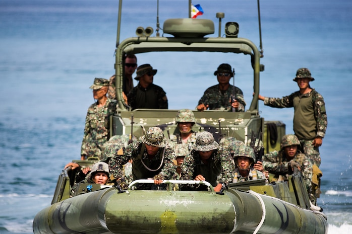Philippine Marines egress from the beach after conducting an amphibious boat landing exercise at the Naval Education and Training Command here May 9. The training evolution, as part of Balikatan 2014, aimed to enhance familiarity between the AFP and the U.S. Marine Corps and strengthen the Philippine-U.S. relationship.