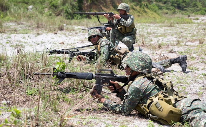 Philippine Marines assigned to 311th Marine Company, 11th Marine Battalion, perform a squad level fire and maneuver technique while their U.S. Marine Corps counterparts supplied suppressive machine gun fire during live-fire exercises May 9, 2014, at Crow Valley, Philippines, for Balikatan 2014. The two nation's Marines partnered together to increase efficiency and effectiveness in assaulting an enemy position. Balikatan is an annual training exercise that strengthens the interoperability between the Armed Forces of the Philippines and U.S. military in their commitment to regional security and stability, humanitarian assistance and disaster relief.
