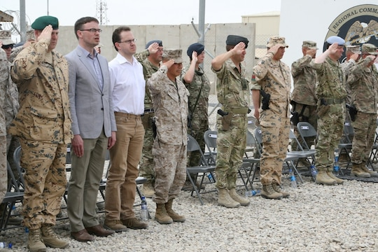 Brigadier Gen. Daniel D. Yoo, center, Commander of Regional Command (Southwest), stands with Estonia's Minister of Defence Sven Mikser, and coalition force officials during a flag- lowering ceremony for the Estonian Contingent aboard Camp Leatherneck, Helmand province, Afghanistan, May 9, 2014. This was the 17th and last Estonian Contingent to deploy to Afghanistan.