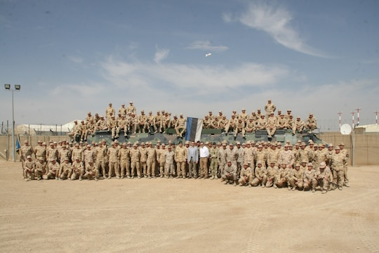 The Estonian Contingent poses for a picture with Estonia's Minister of Defence, Sven Mikser, center, and other coalition force officials after their farewell ceremony held aboard Camp Bastion, Helmand province, Afghanistan, May 9, 2014. This was the 17th and last Estonian Contingent to deploy to Afghanistan.